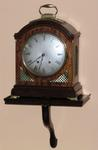 MAHOGANY AND BRASS BRACKET MANTEL CLOCK